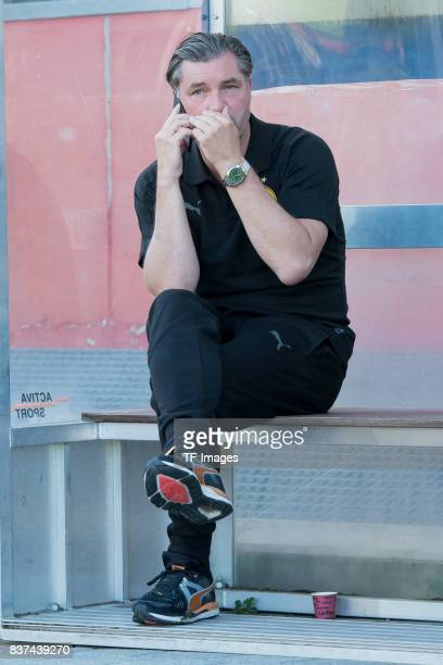 Michael Zorc of Dortmund on the phone during a friendly match between Espanyol Barcelona and Borussia Dortmund as part of the training camp on July...