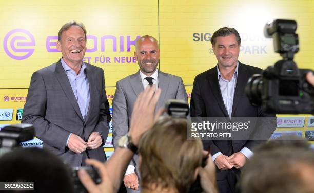 Michael Zorc teammanager of German first division football club Borussia Dortmund and the club's CEO HansJoachim Watzke pose with the team's new...
