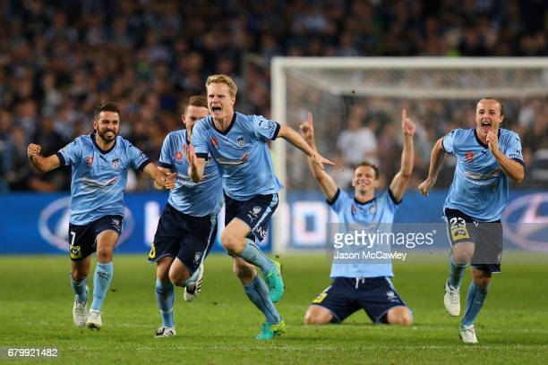 Michael Zullo Brandon O'Neill Matt Simon Rhyan Grant of Sydney celebate winning the 2017 ALeague Grand Final match between Sydney FC and the...