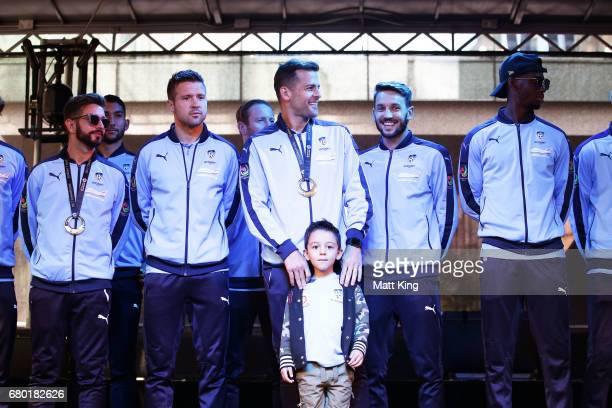 Michael Zullo Milos Dimitrijevic Bobo Milos Ninkovic and Bernie IbiniIsei of Sydney FC appear on stage in Pitt St Mall on May 8 2017 in Sydney...