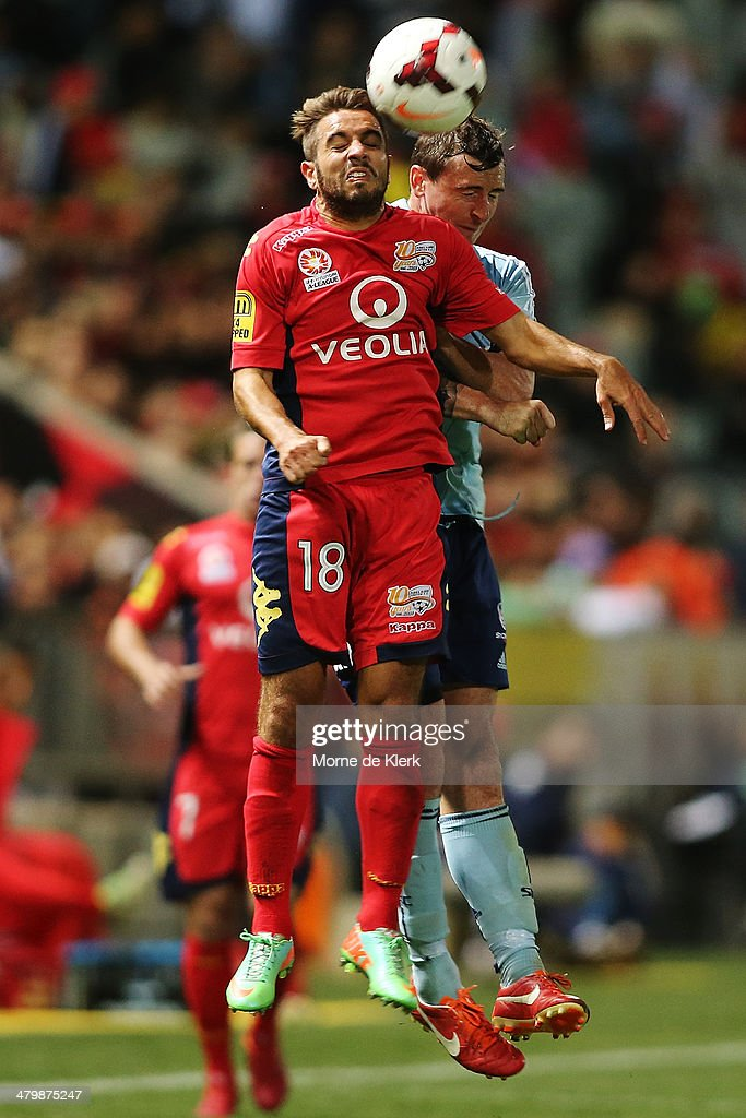 Michael Zullo of Adelaide competes in the air with Sebastian Ryall of Sydney during the round 24 A-League match between Adelaide United and Sydney FC at Coopers Stadium on March 21, 2014 in Adelaide, Australia.