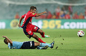 Michael Zullo of Adelaide is tackled by Hagi Gligor of Sydney during the round 18 ALeague match between Sydney FC and Adelaide United at Allianz...