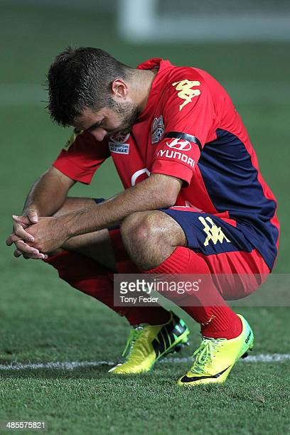 Michael Zullo of Adelaide looks dejected after his team lost to the Mariners during the ALeague Elimination Final match between the Central Coast...