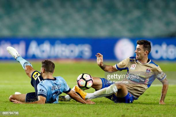 Michael Zullo of Sydney FC competes for the the ball with Jason Hoffman of the Newcastle Jets during the round 27 ALeague match between Sydney FC and...