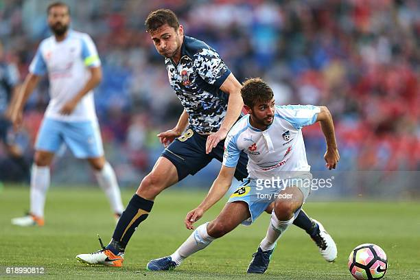 Michael Zullo of Sydney FC contests the ball with Mateo Poljak of the Jets during the round four ALeague match between the Newcastle jets and Sydney...