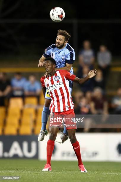 Michael Zullo of Sydney FC heads the ball over Bruce Kamau of City FC during the FFA Cup Quarter Final match between Sydney FC and Melbourne City at...