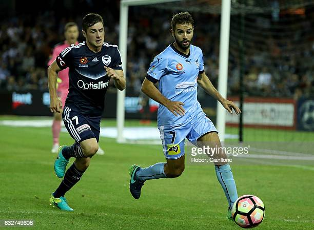 Michael Zullo of Sydney FC is chased Marco Rojas of the Victory during the round 17 ALeague match between the Melbourne Victory and Sydney FC at...