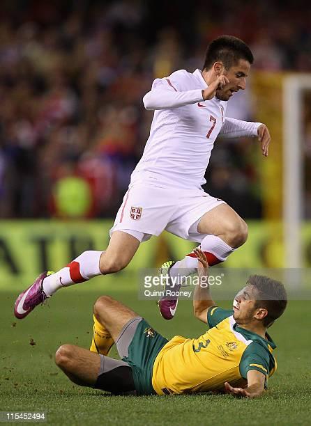 Michael Zullo of the Socceroos tackles Zoran Tosic of Serbia during the international friendly match between the Australian Socceroos and Serbia at...
