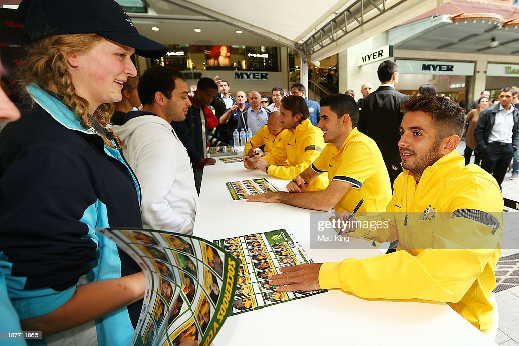 Michael Zullo signs autographs for fans during an Australian Socceroos public appearance at Westfield Sydney on November 12, 2013 in Sydney, Australia.