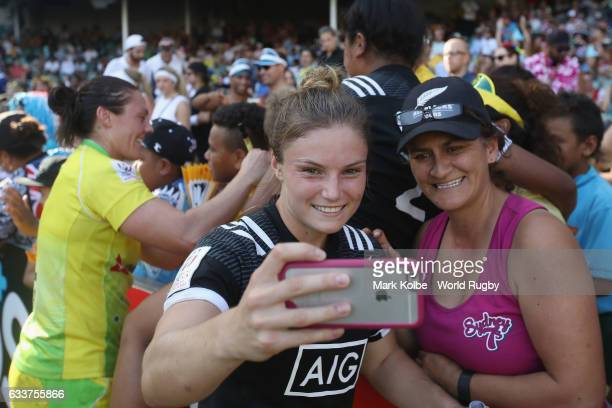 Michaela Blyde of New Zealand poses for a selfie with a person in the crowd after winning the womens bronze cup match between New Zealand and...