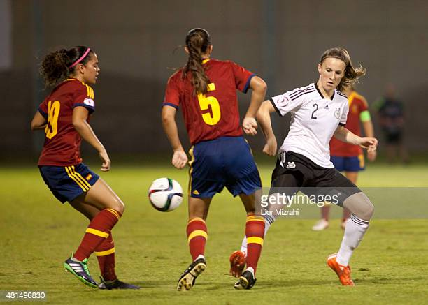 Michaela Brandenburg of Germany challenges Rebecca Knaak of Spain during the UEFA Women's Under19 European Championship group stage match between U19...