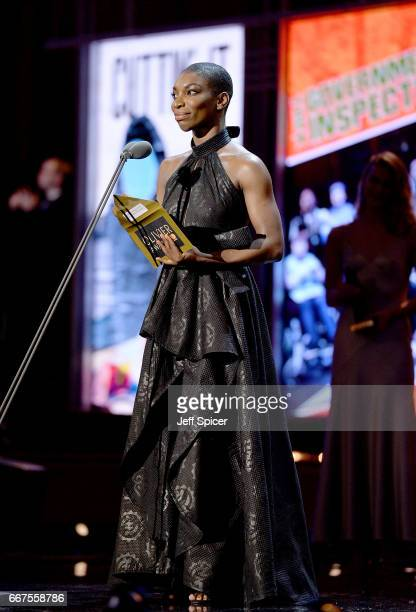 Michaela Coel presents the Outstanding Achievement in an Affiliate Theatre award on stage during The Olivier Awards 2017 at Royal Albert Hall on...