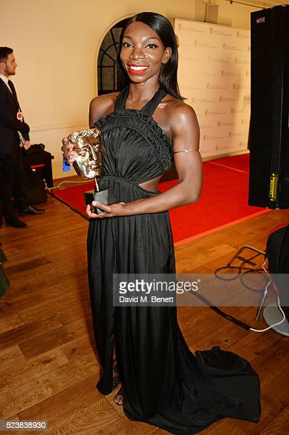Michaela Coel winner of the Breakthrough Talent award for 'Chewing Gum' poses in the winners room at the British Academy Television Craft Awards at...