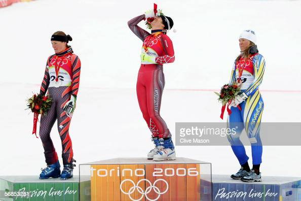 Michaela Dorfmeister of Austria cries on the podium after receiving the gold medal next to Martina Schild of Switzerland and Anja Paerson of Sweden...