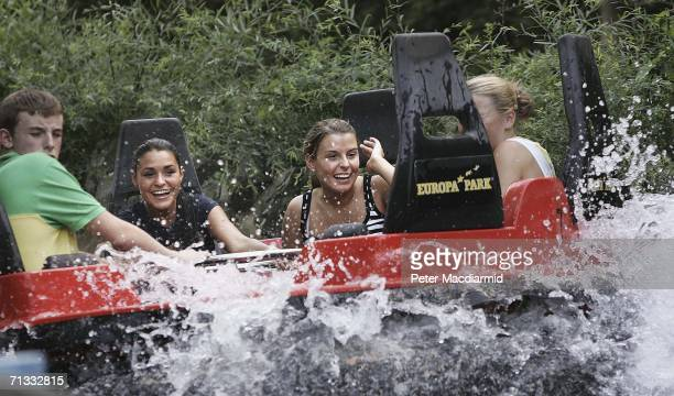 Michaela HendersonThyne girlfriend of Stewart Downing and Coleen McLaughlin laugh after getting a soaking at the Europa theme park on June 29 2006...
