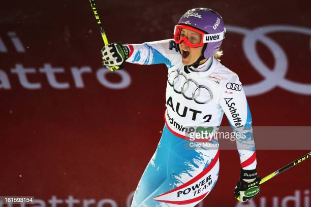 Michaela Kirchgasser of Austria celebrates as she wins her heat on the way to Austria winning the Men and Women's Nations Team Event during the...