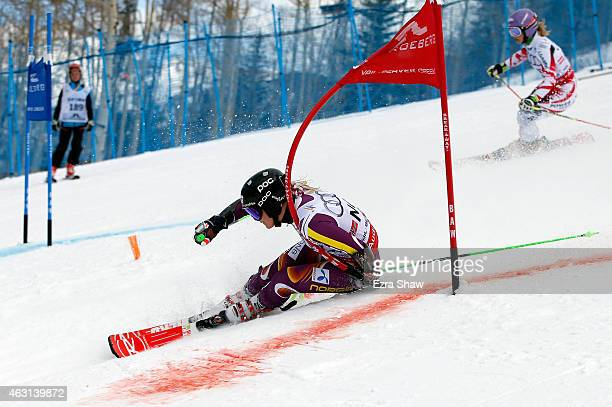 Michaela Kirchgasser of Austria races Ragnhild Mowinckel of Norway during the Nations Team Event at Golden Peak Stadium on Day 9 of the 2015 FIS...