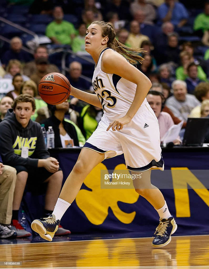 Michaela Mabrey #23 of the Notre Dame Fighting Irish dribbles the ball up court during the game against the Louisville Cardinals at Purcel Pavilion on February 11, 2013 in South Bend, Indiana. Notre Dame defeated Louisville 93-64.