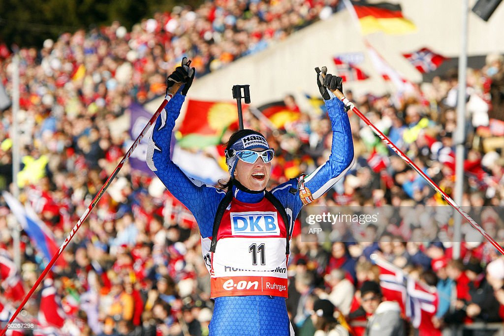 Michaela Ponza of Italy reacts as she crosses the finish line to place third in women's 125 km mass start at the World Cup Biathlon ski race in Oslo...