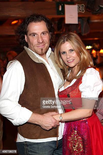 Michaela Schaffrath and her boyfriend Carlos Anthonyo during Oktoberfest at Kaeferzetl/Theresienwiese on October 5 2014 in Munich Germany