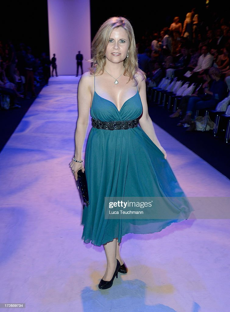 Michaela Schaffrath attends the Irene Luft Show during the Mercedes-Benz Fashion Week Spring/Summer 2014 at Brandenburg Gate on July 4, 2013 in Berlin, Germany.