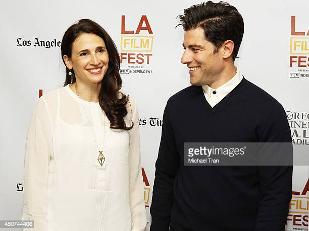 Michaela Watkins and Max Greenfield arrive at the Los Angeles premiere of 'They Came Together' during the 2014 Los Angeles Film Festival held at...