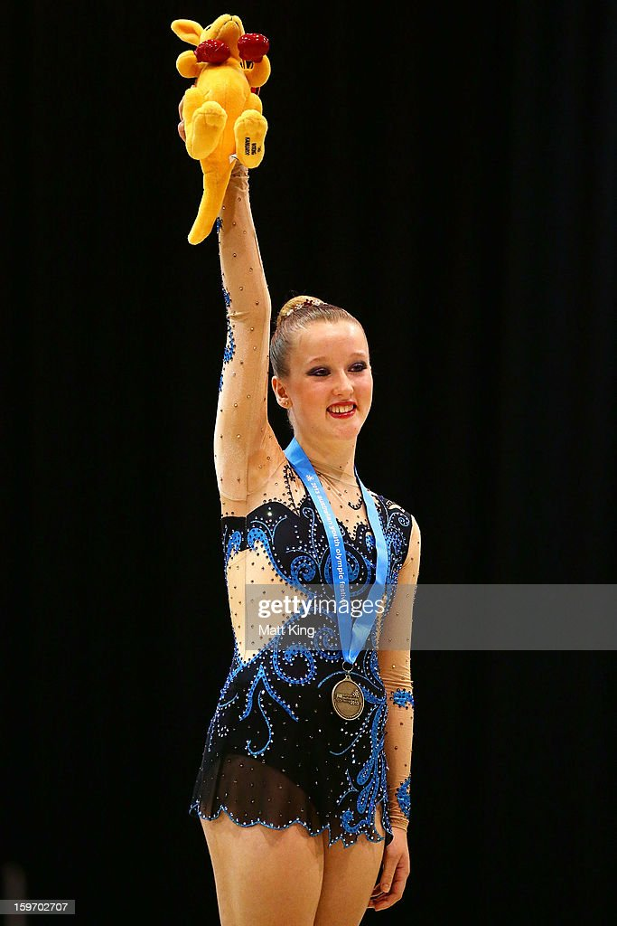 Michaela Whitehouse of Australia celebrates receiving her gold medal in the Women's Rhythmic Gymnastics during day four of the Australian Youth Olympic Festival at Sydney Olympic Park Sports Centre on January 19, 2013 in Sydney, Australia.