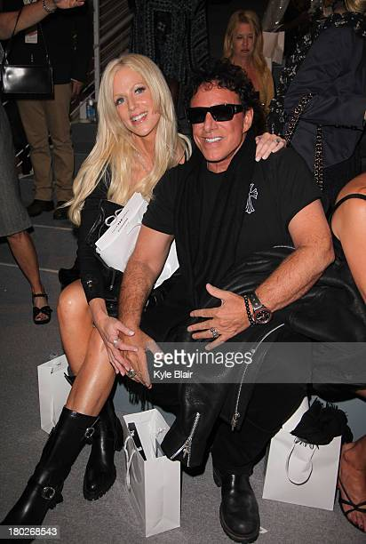 Michaele Salahi and Neal Schon attend the Zang Toi show during Spring 2014 MercedesBenz Fashion Week at The Stage at Lincoln Center on September 10...