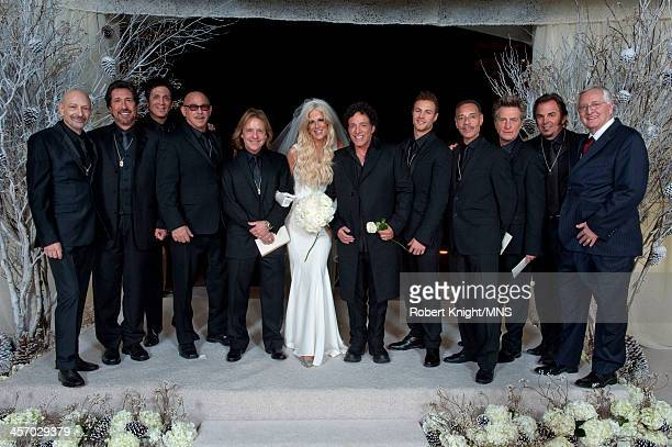 Michaele Schon and Neal Schon pose with the groomsmen including Miles Schon Mike Carabello Ross Valory and Jonathan Cain at their wedding at the...