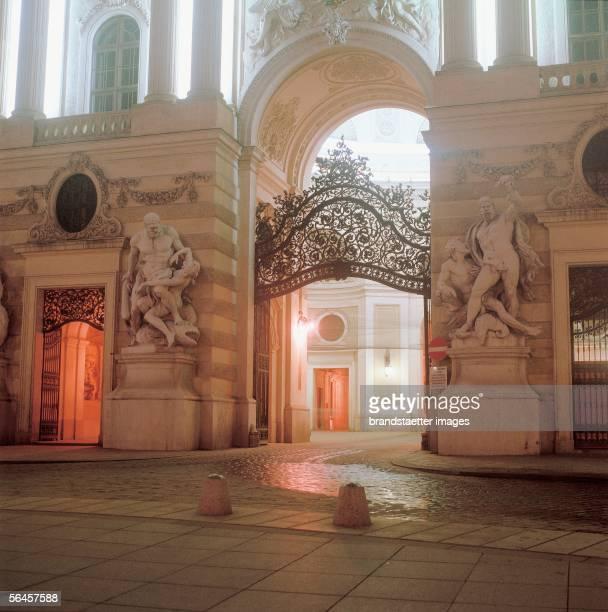Michaelertor entrance of the 'Michaelertrakt' of the Hofburg Photography [Wien Hofburg Das beleuchtete Michaelertor des Michaelertrakts der Hofburg...