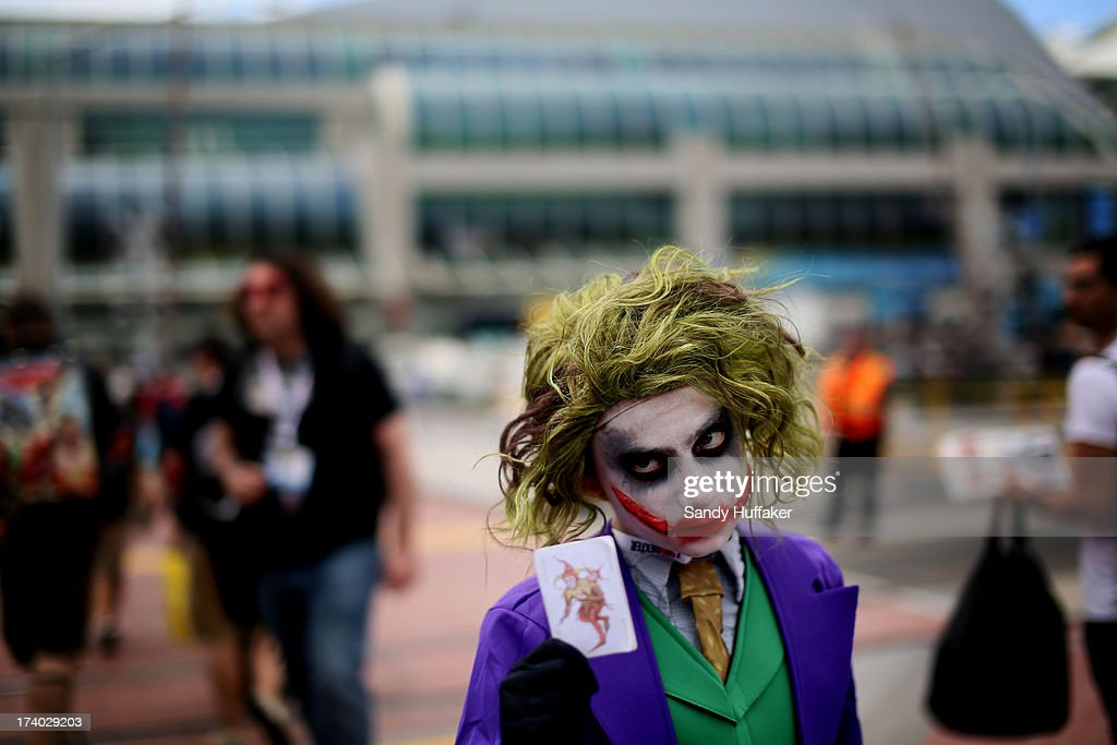 Michaell Cherry shows his Joker costume during Comic Con at the San Diego Convention Center on July 19, 2013 in San Diego, California. Comic Con International Convention is the world's largest comic and entertainment event and hosts celebrity movie panels, a trade floor with comic book, science fiction and action film-related booths, as well as artist workshops and movie premieres.