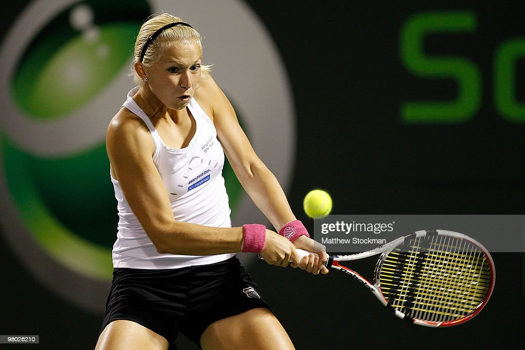 <a gi-track='captionPersonalityLinkClicked' href=/galleries/search?phrase=Michaella+Krajicek&family=editorial&specificpeople=233800 ng-click='$event.stopPropagation()'>Michaella Krajicek</a> of the Netherlands returns a shot against Melanie Oudin of the United States during day two of the 2010 Sony Ericsson Open at Crandon Park Tennis Center on March 24, 2010 in Key Biscayne, Florida.