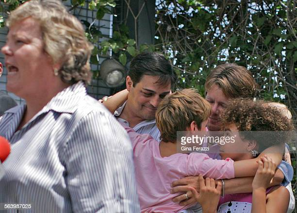 Michaelleft and Jon Galluccio with their children Adam and Madison embrace in the background as Lorri Jean CEO of the LA Gay and Lesbian Center and...