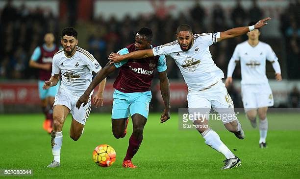 Michail Antonio of West Ham and Ashley Williams of Swansea City battle for the ball during the Barclays Premier League match between Swansea City and...