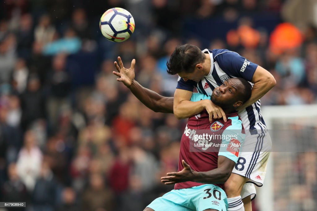 Michail Antonio of West Ham United and Gareth Barry of West Bromwich Albion during the Premier League match between West Bromwich Albion and West Ham United at The Hawthorns on September 16, 2017 in West Bromwich, England.