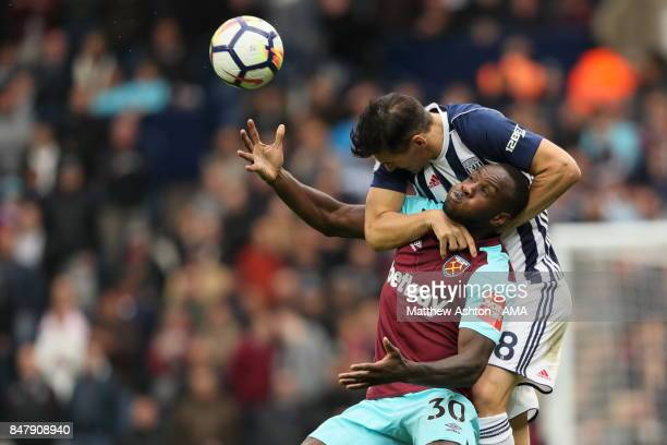 Michail Antonio of West Ham United and Gareth Barry of West Bromwich Albion during the Premier League match between West Bromwich Albion and West Ham...
