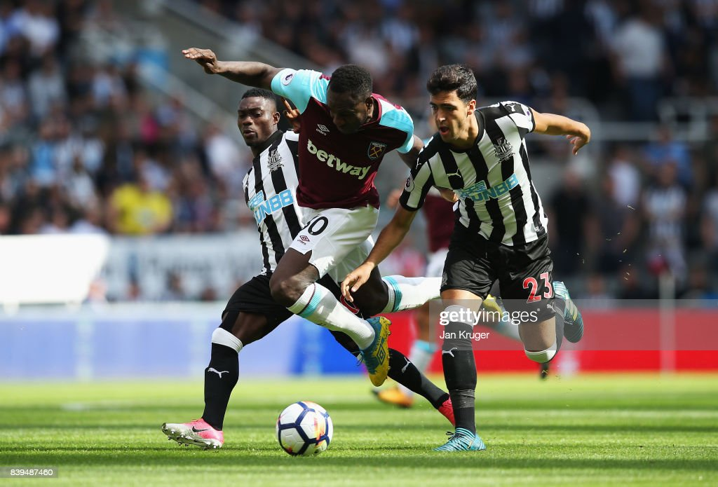 Michail Antonio of West Ham United and Mikel Merino of Newcastle United battle for possession during the Premier League match between Newcastle United and West Ham United at St. James Park on August 26, 2017 in Newcastle upon Tyne, England.