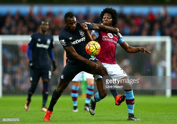 Michail Antonio of West Ham United battles for the ball with Carlos Sanchez of Aston Villa during the Barclays Premier League match between Aston...