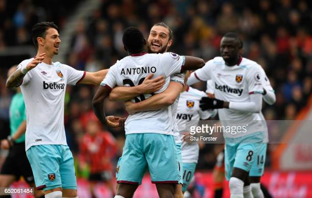 Michail Antonio of West Ham United celebrates scoring his sides first goal with Andy Carroll of West Ham United during the Premier League match...
