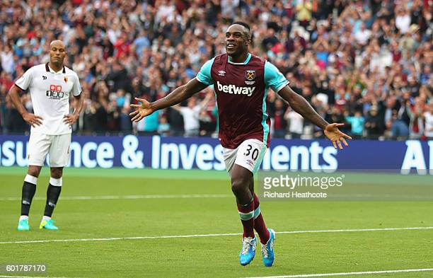 Michail Antonio of West Ham United celebrates scoring his sides second goal during the Premier League match between West Ham United and Watford at...