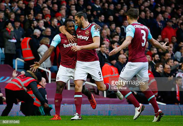 Michail Antonio of West Ham United celebrates scoring his team's first goal with his team mates Andy Carroll and Aaron Cresswell during the Barclays...