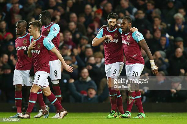 Michail Antonio of West Ham United celebrates scoring his team's first goal with his team mates during the Barclays Premier League match between West...