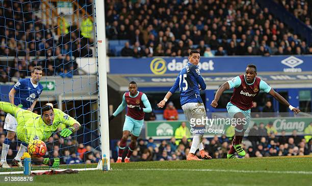 Michail Antonio of West Ham United celebrates scoring his team's first goal during the Barclays Premier League match between Everton and West Ham...