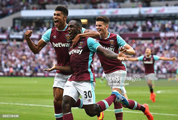 Michail Antonio of West Ham United celebrates scoring the opening goal with team mates during the Premier League match between West Ham United and...
