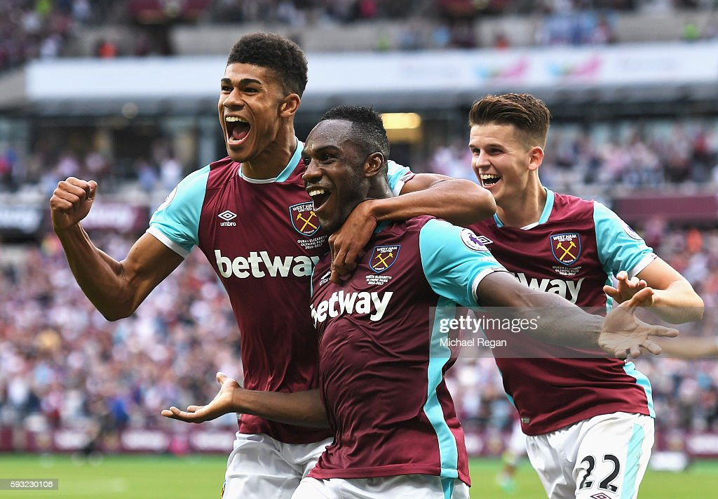 Michail Antonio (C) of West Ham United celebrates scoring the opening goal with team mates Ashley Fletcher (L) and Sam Byram during the Premier League match between West Ham United and AFC Bournemouth at London Stadium on August 21, 2016 in London, England.