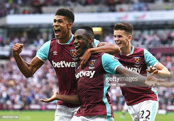 Michail Antonio of West Ham United celebrates scoring the opening goal with team mates Ashley Fletcher and Sam Byram during the Premier League match...