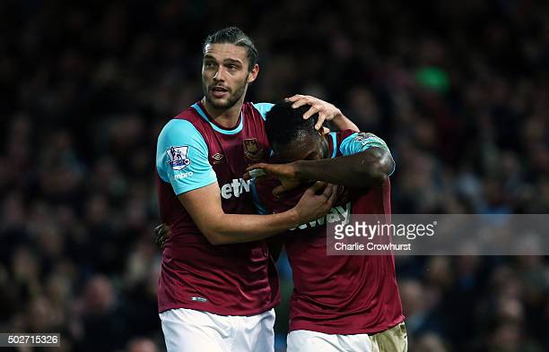 Michail Antonio of West Ham United celebrates with Andy Carroll of West Ham United after deflecting the ball into the net for his side's first goal...