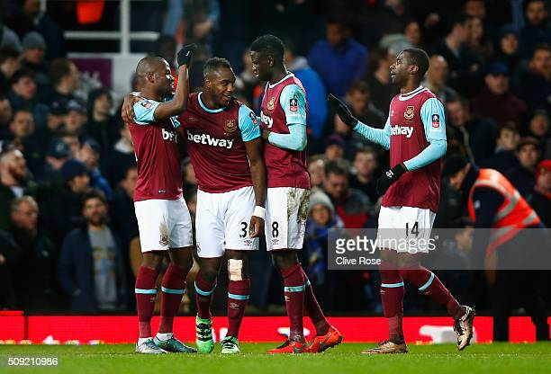 Michail Antonio of West Ham United celebrates with Enner Valencia Cheikhou Kouyate and Pedro Mba Obiang as he scores their first goal during the...