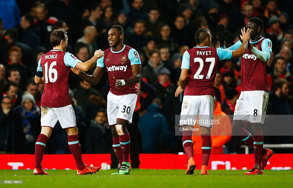 <a gi-track='captionPersonalityLinkClicked' href=/galleries/search?phrase=Michail+Antonio&family=editorial&specificpeople=5806303 ng-click='$event.stopPropagation()'>Michail Antonio</a> of West Ham United (30) celebrates with <a gi-track='captionPersonalityLinkClicked' href=/galleries/search?phrase=Mark+Noble&family=editorial&specificpeople=844055 ng-click='$event.stopPropagation()'>Mark Noble</a> (16), <a gi-track='captionPersonalityLinkClicked' href=/galleries/search?phrase=Dimitri+Payet&family=editorial&specificpeople=2137146 ng-click='$event.stopPropagation()'>Dimitri Payet</a> (27) and Cheikhou Kouyate (8) as he socres their first goal during the Emirates FA Cup Fourth Round Replay match between West Ham United and Liverpool at Boleyn Ground on February 9, 2016 in London, England.