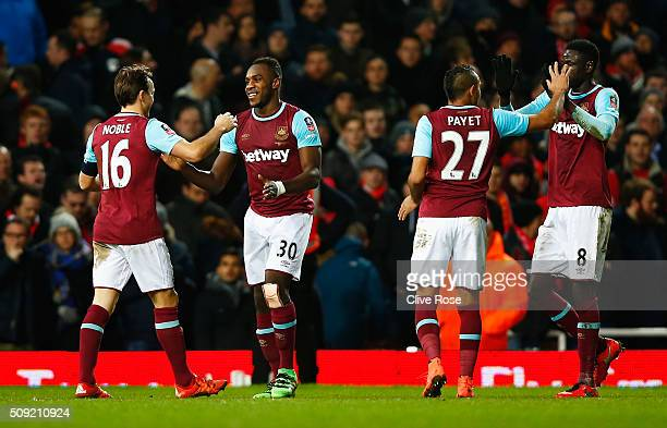 Michail Antonio of West Ham United celebrates with Mark Noble Dimitri Payet and Cheikhou Kouyate as he socres their first goal during the Emirates FA...